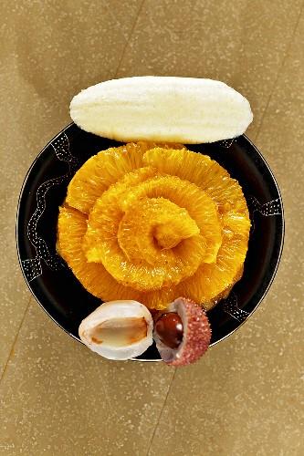 Orange tart with banana ice cream and lychees