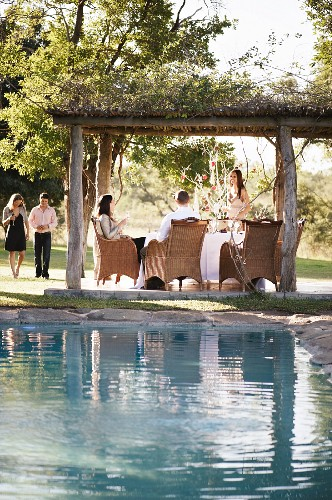 People in a garden with a pool
