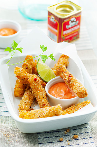 Chicken and cheese fried breaded sticks with spicy sauce