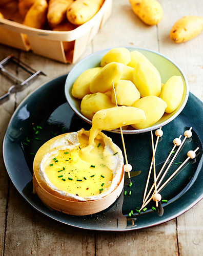 Potatoes with melted Camembert