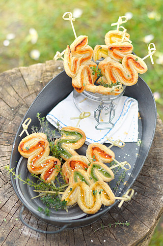 Three colored pesto zigzag puff pastry appetizers outdoors