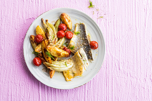 Fillet of fish with fennel, potatoes and cherry tomatoes