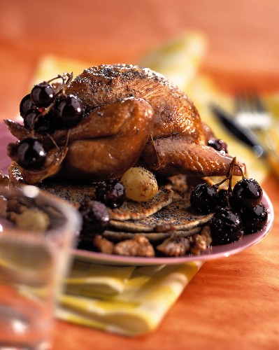 Pigeon with grapes and walnuts and poppy seed pancakes