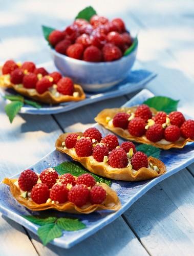 Raspberries in filo pastry boats