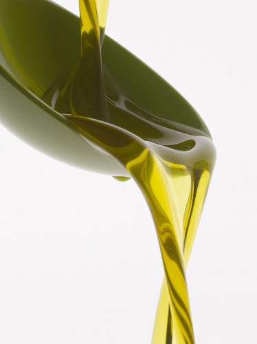 Pouring olive oil into a spoon