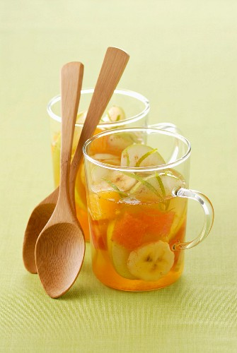 Apple soup with bananas, oranges and cinnamon