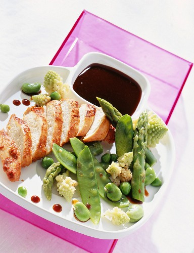 Marinated turkey breast, roasted green vegetables and a balsamic vinegar reduction