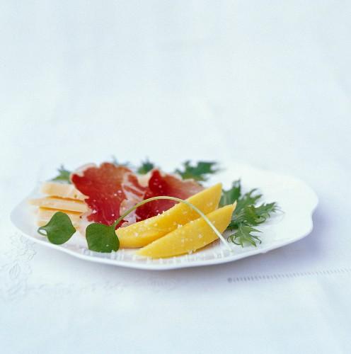 Italian dish with coppa, Asiago cheese, Mizuna and Mango