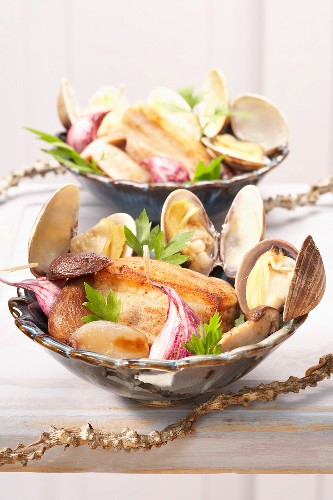 Thick piece of bacon with little neck clams and ceps