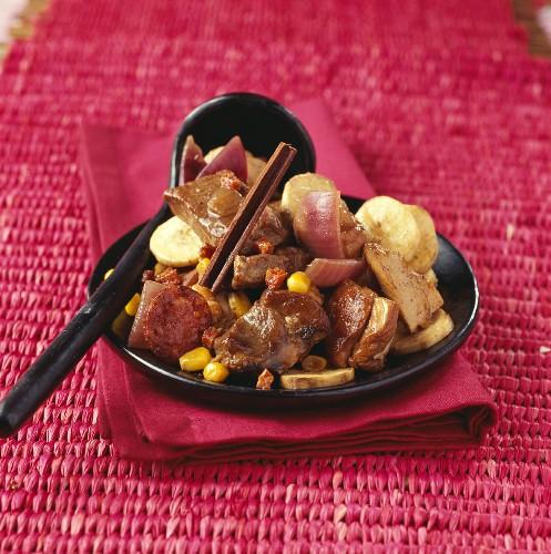 Pork, chicken and banana stew