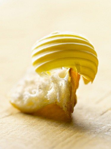 Knob of butter on a piece of bread