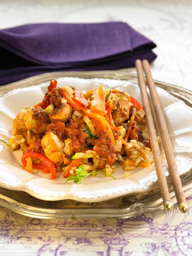 Rice with chicken, tomato, red pepper and ginger