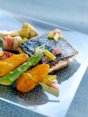 Thick piece of roast bass ,asparagus and saffron potato brochette