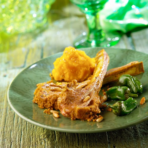Lamb chips with turmeric and pine nuts,pumpkin mash and green peppers