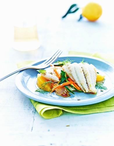 Cod fillets in orange sauce with vegetables