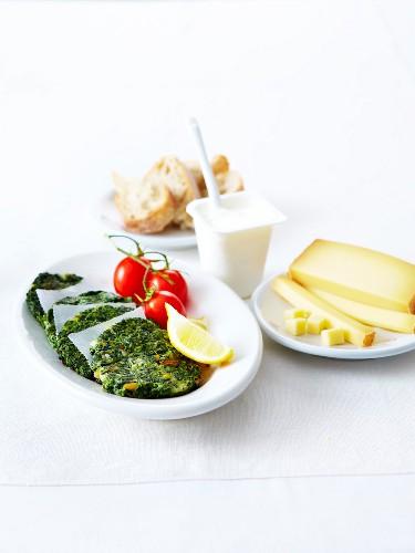 Spinach and pine nut patties, Comté and a plain yoghurt