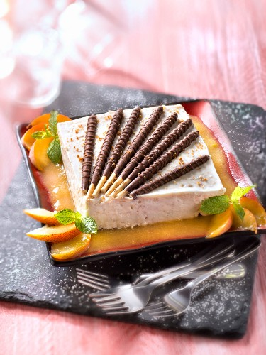 Fromage blanc cake with peach puree and King choco Mikados