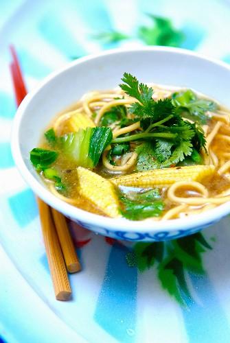 Noodle, mini corn on the cob and cilantro broth