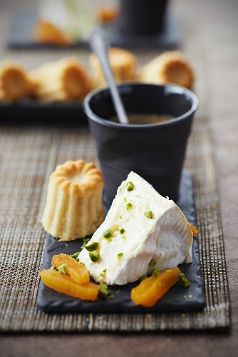 Camembert with dried apricots and pistachios,cardamom Cannelés