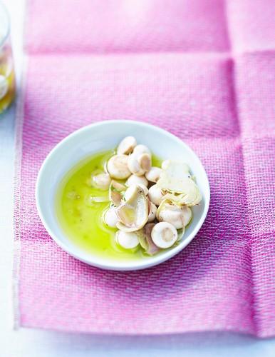 Mushroom salad with artichokes marinated in essential oils