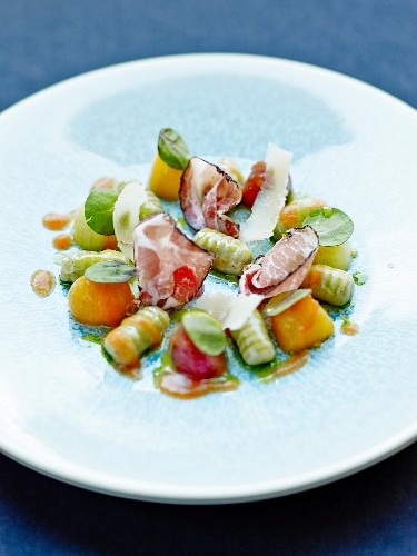 Gnocchis with tomato coulis,Corsican ham,basil and parmesan by Anne-Sophie Pic