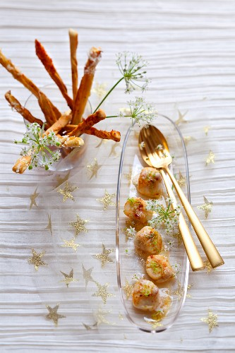 Pan-fried scallops marinated in in ginger,chili pepper-coconut breadsticks