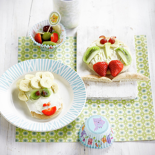 Funny face and owl's face fromage frais and fruit on pita bread