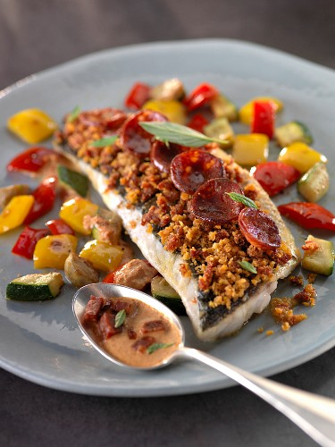 Bass with sliced chorizo and crisp vegetables