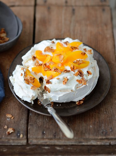 Peach and caramelized thinly sliced almond Pavlova
