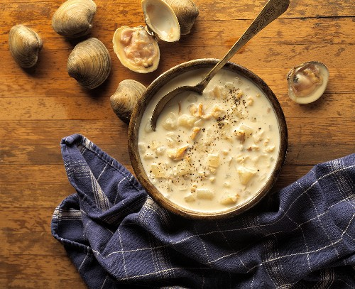 Clam Chowder in a Wooden Bowl with a Wooden Spoon; Fresh Clam