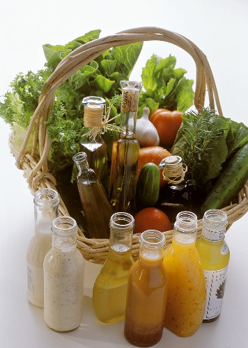 Salad Ingredients in a Basket; Assorted Oils and Dressings