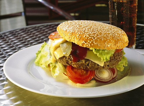 Cheeseburger on Plate in a Restaurant