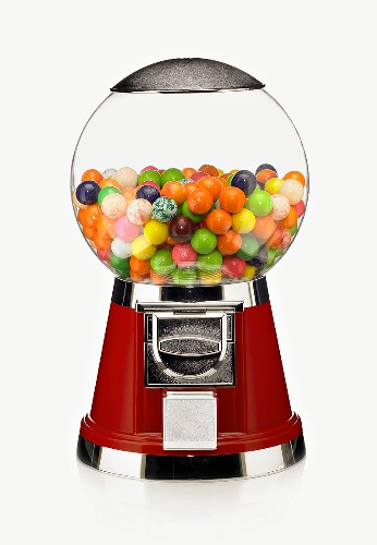 A Candy Machine Half Filled with Gumballs