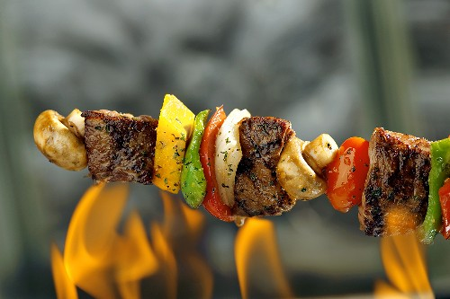 Beef and vegetable kebab over a fire
