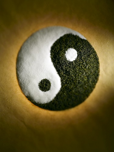 Yin and Yang Sign Made From White Sugar and Black Tea, Overhead