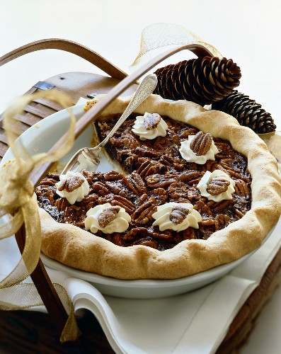Pecan Pie in Baking Dish With Slice Removed; On Basket with Ribbon