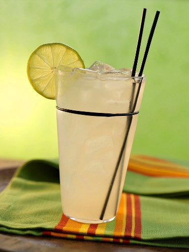 Rita Drink with Lime Slice and Two Plastic Stirrers