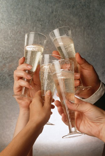 Four Hands Toasting with Champagne