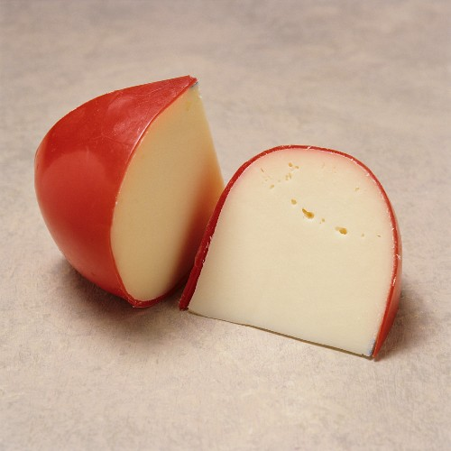 Two Wedges of Baby Gouda Cheese with Red Wax