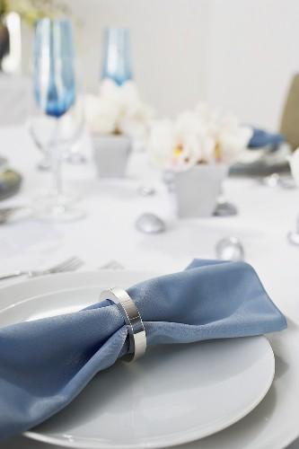 Blue Cloth Napkin on Place Setting on Table Set for Hanukkah Dinner
