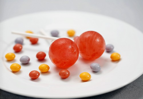 Two Lollipops with Colorful Candies on a Plate