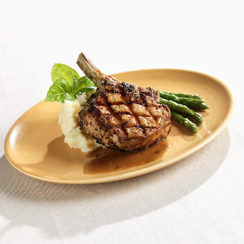Fire Grilled Veal Chop with Mashed Potatoes and Asparagus