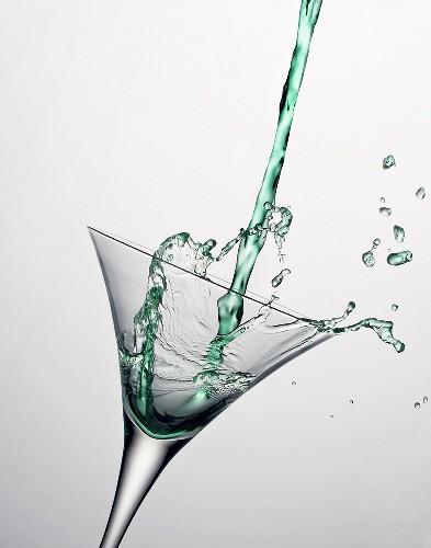 Green Martini Pouring into a Glass