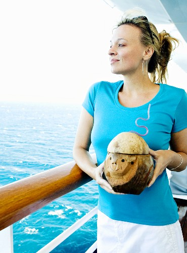 Woman on Cruise Holding Coconut Beverage