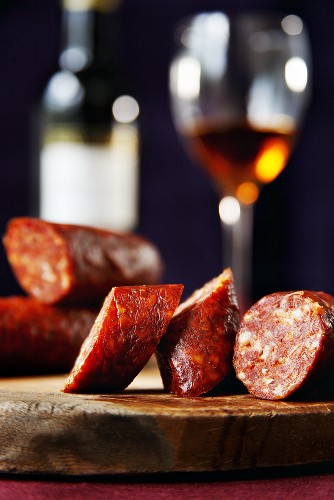 Hungarian Chorizo on a Cutting Board; Glass of Sherry