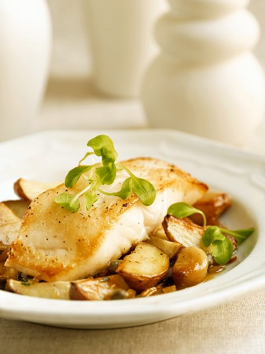 Cod Fillet Over Roast Potatoes and Garlic