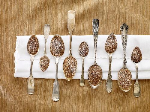 Nine Spoon Madeleines with Powdered Sugar on a White Napkin