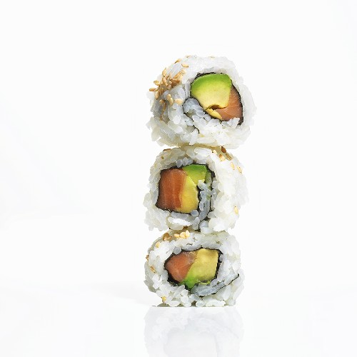 Stacked Inside Out Ura-Maki Roll Sushi with Salmon and Avocado