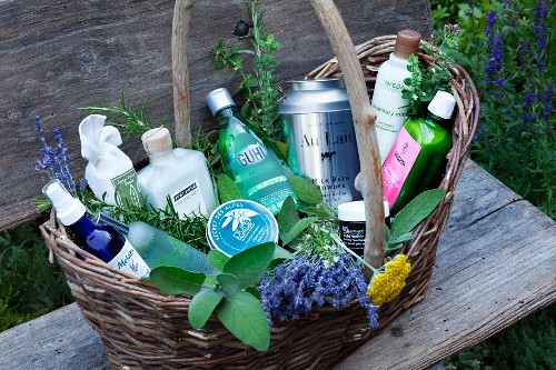 Basket with bath and body products in a gardne