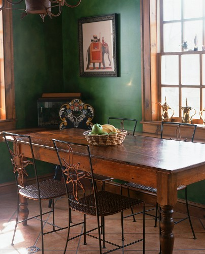 A dining table and chairs in an old country house